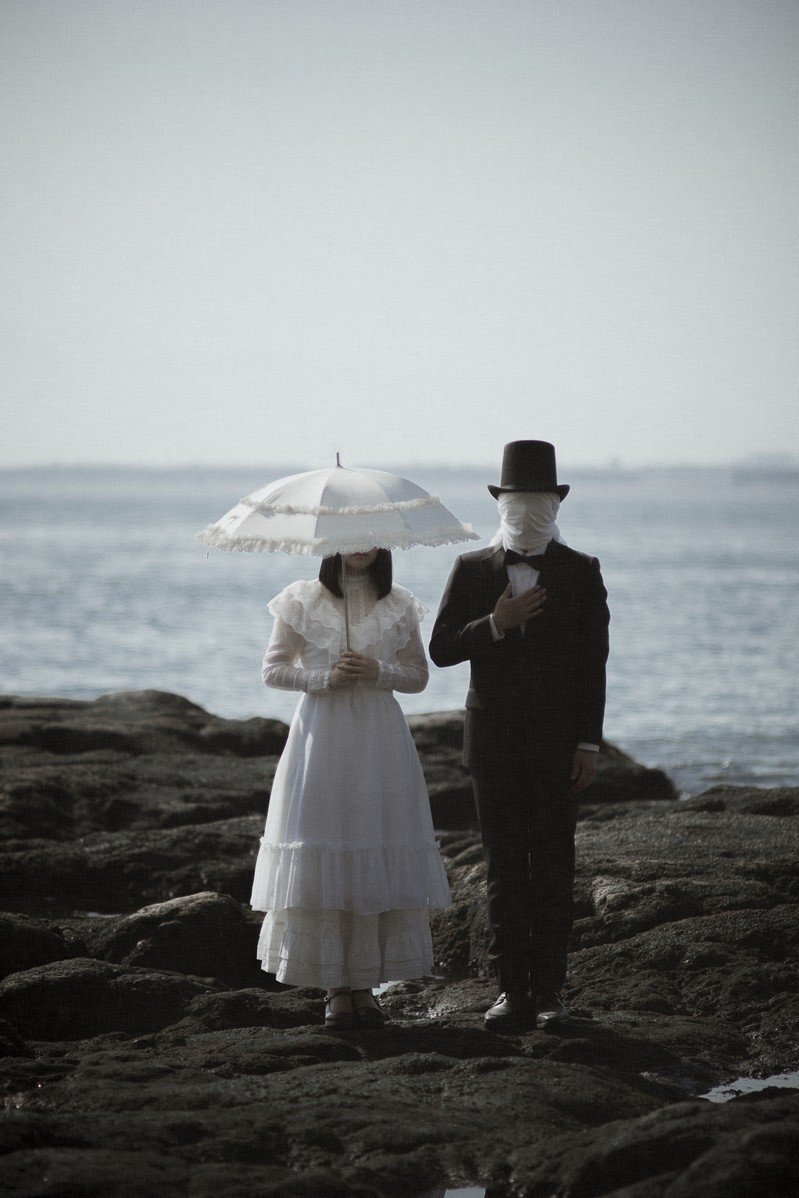覆面夫妻の写真